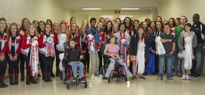 Sidekicks Present Homecoming Mums to Special Needs Students