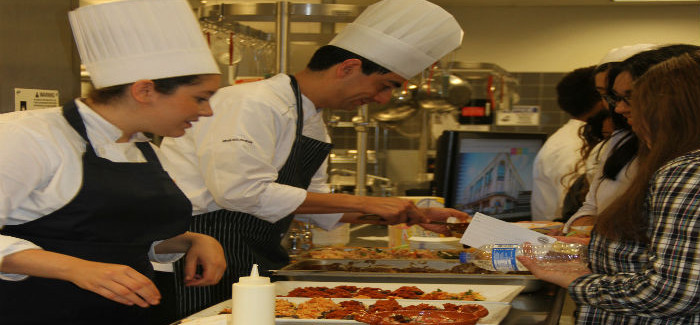 Professionals Serve Young Chefs Traditional Dish