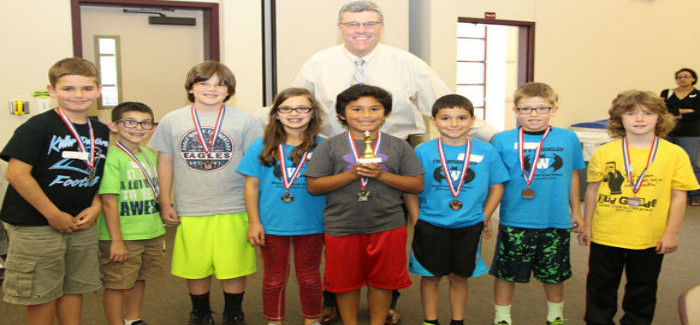 3rd Graders Compete at KISD Chess Tournament, ERES Student Crowned Champion