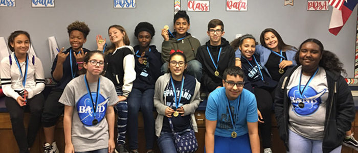 HEB ISD: Adopter Partners with Central Junior High to Award 620 Perfect Attendance Medals