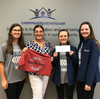 KHS BAND SUPPORTS COMMUNITY STOREHOUSE WITH DROP THE MUM PROGRAM